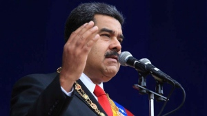 In this photo provided by the Miraflores Presidential Palace, President Nicolas Maduro speaks during a event marking the 81st anniversary of the National Guard, in Caracas, Venezuela, Saturday, August 4, 2018. (Miraflores Presidential Palace via AP)