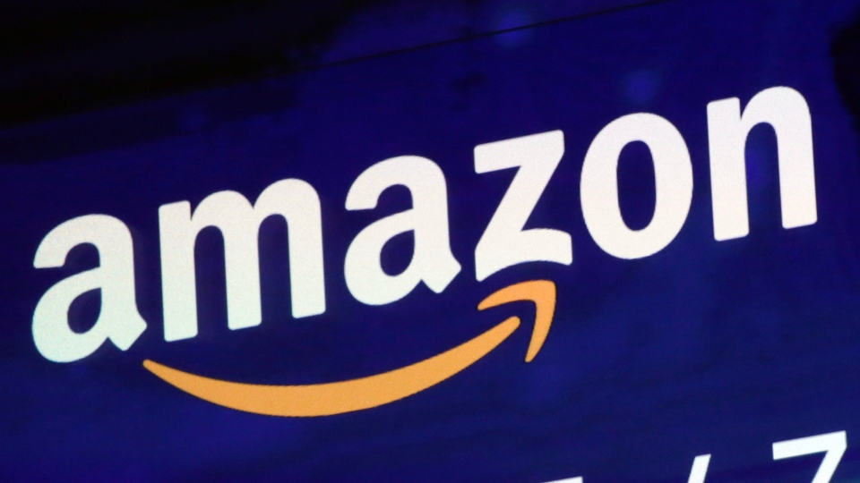 In this Friday, July 27, 2018 file photo, the logo for Amazon is displayed on a screen at the Nasdaq MarketSite. (AP Photo/Richard Drew, file)