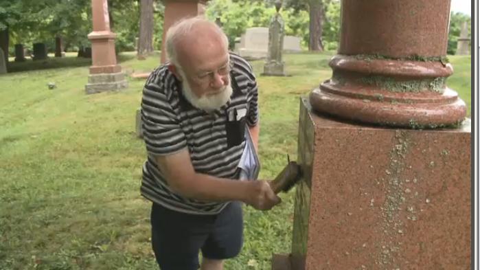 Amateur genealogist Bill Graham carefully cleans headstones at a New Glasgow, N.S. cemetery.
