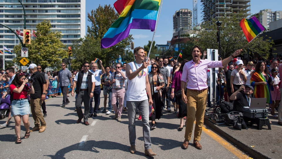 Prime Minister Justin Trudeau, right, and Vancouver mayor Gregor Robertson, centre, march in the Pride Parade in Vancouver, on Sunday August 5, 2018. THE CANADIAN PRESS/Darryl Dyck