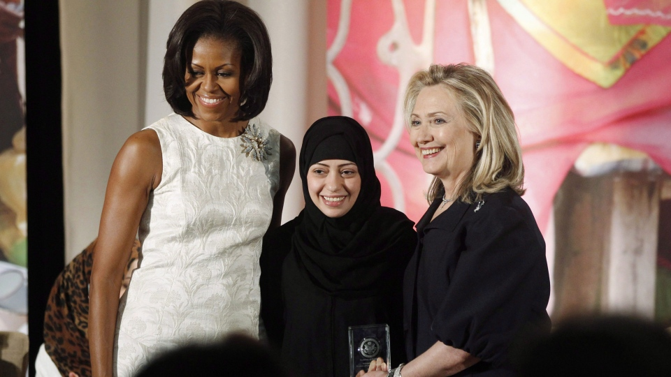 Secretary of State Hillary Rodham Clinton and first lady Michelle Obama present the 2012 International Women of Courage Award to Samar Badawi of Saudi Arabia, on the 101st Anniversary of International Women's Day, Thursday, March 8, 2012, at the State Department in Washington. THE CANADIAN PRESS/AP-Charles Dharapak