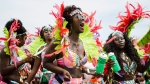 Millions of people took over Toronto&#39;s Lake Shore Boulevard for the 51st annual Caribbean Carnival parade. Masqueraders donned elaborate and colourful costumes as tourists and spectators lined the street to catch a glimpse. 