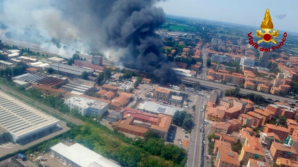 In this photo released by the Italian firefighters, an helicopter view of the explosion on a highway in the outskirts of Bologna, Italy, Monday, Aug. 6, 2018. (Vigili Del Fuoco via AP)