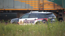 Police vehicle next to a VIA Rail train