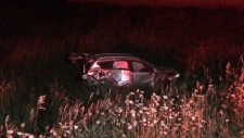 A vehicle in the ditch after rolling over