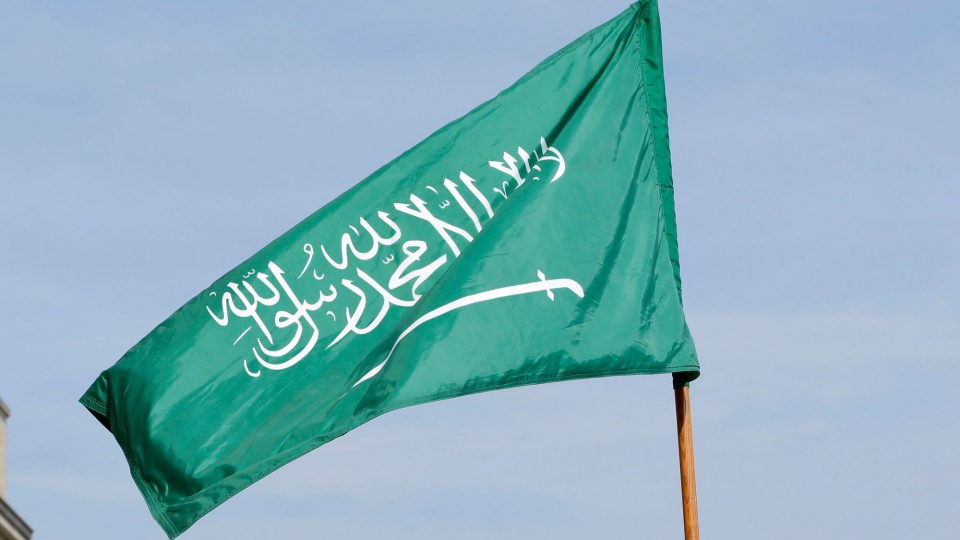 Saudi Arabia's flag is held by U.S. honor cordon soldiers before the arrival at the Pentagon of Saudi Arabia's Chief of the General Staff Lt. Hussein bin Abdullah Al-Qabil, at the Pentagon, Thursday, Sept. 27, 2012. (AP / Jacquelyn Martin)