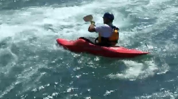Kayaker enjoys Harvie Passage