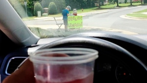 This Saturday, Aug. 4, 2018, photo provided by James Castellano, of Monroe, N.C., shows a drink he bought from a boy with a lemonade stand. (James Castellano via AP)