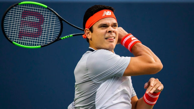 Canada's Milos Raonic returns a shot David Goffin of Belgium during the first round of the Men's Rogers Cup tennis tournament in Toronto, Monday August 6, 2018. THE CANADIAN PRESS/Mark Blinch