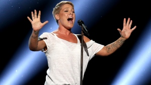 """FILE - In this Jan. 28, 2018, file photo, Pink performs """"Wild Hearts Can't Be Broken"""" at the 60th annual Grammy Awards at Madison Square Garden in New York. (Photo by Matt Sayles/Invision/AP, File)"""