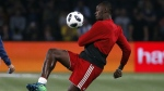 Former Olympic and Jamaican sprinter Usain Bolt controls the ball during a training session prior to the charity soccer match at the U Arena in Nanterre, France, on June 12, 2018. (Thibault Camus / AP)