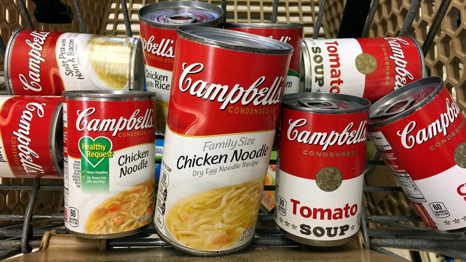 This May 23, 2017, file photo shows a variety of Campbell's soups in a grocery cart at a store in Phoenix.  (AP Photo/Ross D. Franklin, File)
