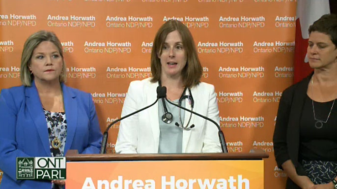 Health care workers join Ontario NDP Leader Andrea Horwath to discuss concerns about the PC government's plan to scrap a revised edition of the sex-ed curriculum at Ontario schools on Aug. 7, 2018.