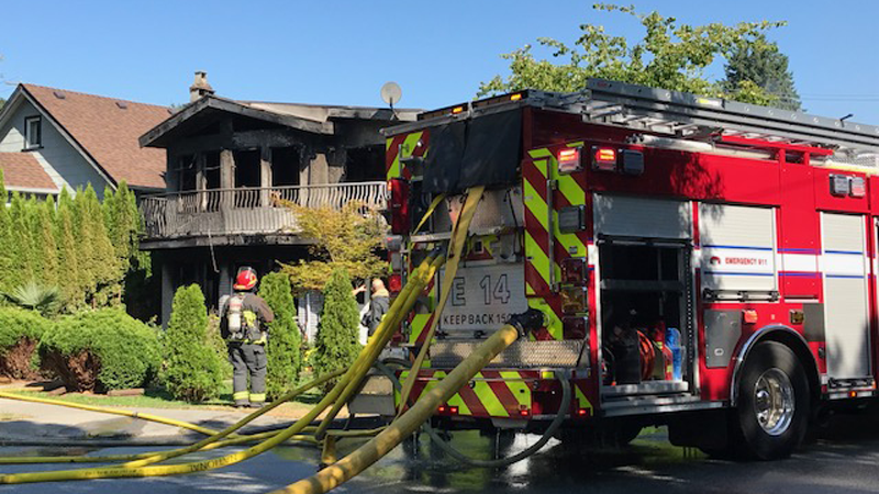Firefighters respond to a blaze that tore through an East Vancouver home Tuesday morning.