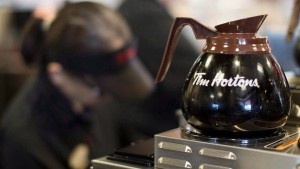 Freshly brewed coffee sits on a hot plate in a Tim Hortons outlet in Oakville, Ont. on Monday September 16, 2013. THE CANADIAN PRESS/Chris Young