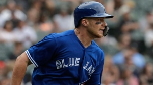 Toronto Blue Jays' Brandon Drury runs to second base after hitting a two-run double against the Chicago White Sox during the ninth inning of a baseball game Sunday, July 29, 2018, in Chicago. (AP Photo/Nam Y. Huh)