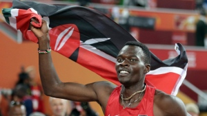 In this Tuesday, Aug. 25, 2015, file photo, Kenya's Nicholas Bett celebrates after winning the men's 400m hurdles final at the World Athletics Championships at the Bird's Nest stadium in Beijing. The ex-hurdles world champion Bett, 28, has been killed in a road accident. (AP Photo/Lee Jin-man, File)
