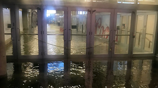 A set of doors in Union Station flooded after a heavy downpour on Aug. 7, 2018. (Twitter/@califoreplay)