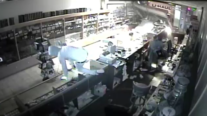 The thieves smashed glass display cases and stuffed memorabilia into bags during the robbery.