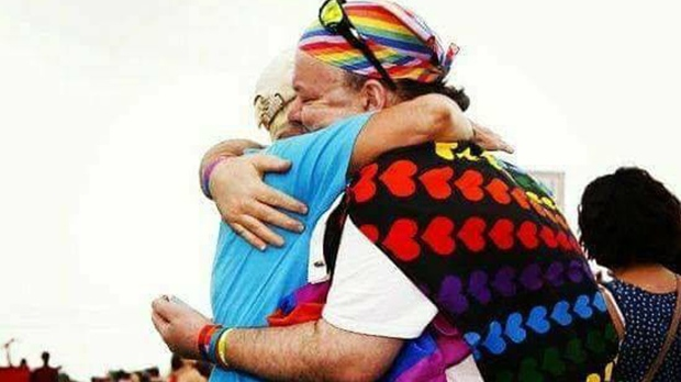 Sara Cunningham gives a hug at a Pride event in Oklahoma City. (Sara Cunningham / Facebook)
