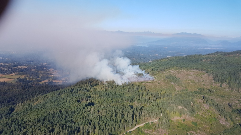 Smoke from a wildfire burning northwest of Port Alberni is shown. Aug. 8, 2018. (BC Wildfire Service)