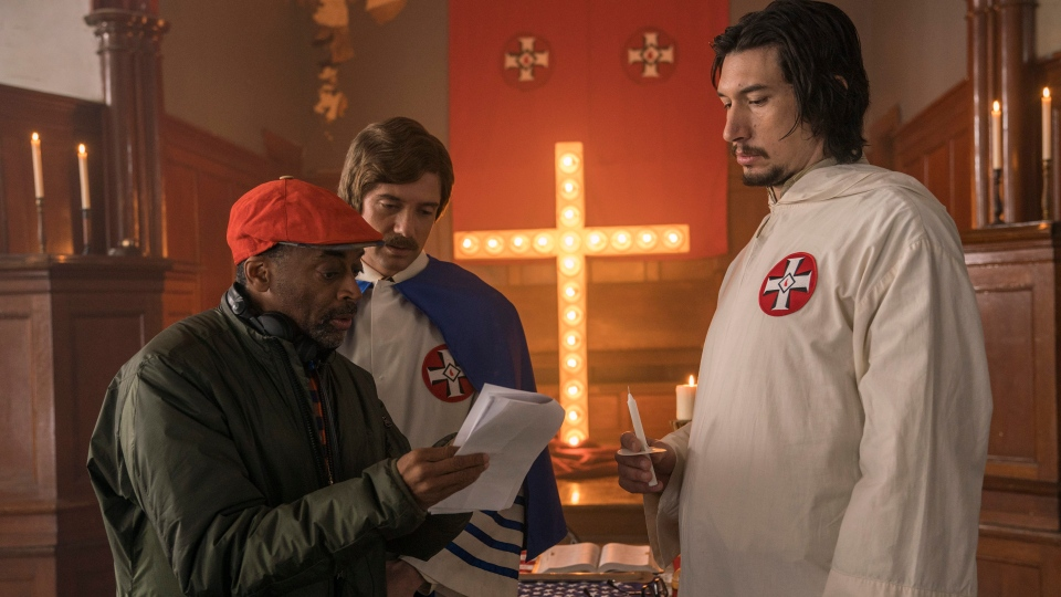 Director Spike Lee, left, with actors Topher Grace, centre, and Adam Driver on the set of 'BlacKkKlansman.' (David Lee / Focus Features via AP)