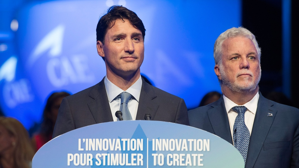 Prime Minister Justin Trudeau, left, and Quebec Premier Philippe Couillard speak to reporters during an investment announcement CAE in Montreal, Wednesday, August 8, 2018.THE CANADIAN PRESS/Graham Hughes