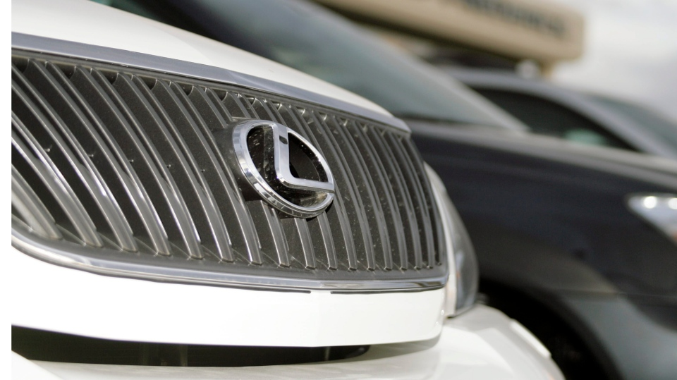 The logo gleams on the chrome grille of an unsold 2007 Lexus RX350 sports utility vehicle parked in front of a Lexus dealership in Frederick, Colo. on Sunday, Oct. 1, 2006. (AP Photo/David Zalubowski)