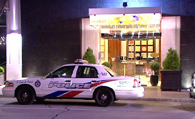 Toronto police arrive at the SoHo Metropolitan Hotel after they received calls concerning Perez Hilton, in downtown Toronto, early Monday, June 22, 2009.