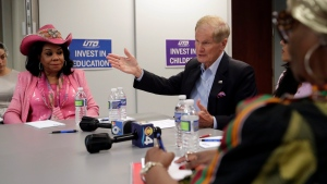 Sen. Bill Nelson, D-Fla., right, speaks during a roundtable discussion with education leaders from South Florida at the United Teachers of Dade headquarters, Monday, Aug. 6, 2018, in Miami. At left is Rep. Frederica Wilson D-Fla. (AP Photo/Lynne Sladky)