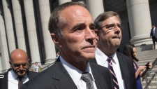 Republican U.S. Rep. Christopher Collins, center, leaves federal court, Wednesday, Aug. 8, 2018, in New York. (AP / Mary Altaffer)