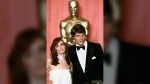 In this April 9, 1979 file photo, actress Margot Kidder, left, and actor Christopher Reeve appear at the 51st Annual Academy Awards ceremony in Los Angeles. Kidder, who starred as Lois Lane in the 'Superman' film franchise of the late 1970s and early 1980s, has died. Franzen-Davis Funeral Home in Livingston, Montana posted a notice on its website saying Kidder died Sunday, May 13, 2918, at her home there. She was 69. (AP Photo/Reed Saxon, File)