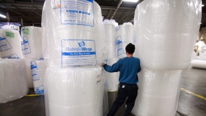 In this Jan. 19, 2010, file photo, Sealed Air employee Eddie Ruiz moves giant rolls of Bubble Wrap at the company's plant in Saddle Brook, N.J. (AP Photo/Christopher Barth)