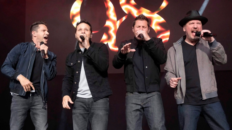 98 Degrees band members, from left, Jeff Timmons, Drew Lachey, Nick Lachey and Justin Jeffre perform at KTUphoria 2018 at Jones Beach Theater in Wantagh, N.Y., on June 16, 2018. (THE CANADIAN PRESS/AP, Invision - Charles Sykes)