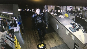 "One of the men was wearing a ""Jason"" mask during a theft at a car dealership."