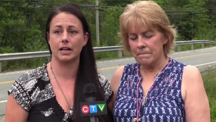 Kylie Cooper's mother Marlene Cooper (left) and grandmother Kathy Best at the scene of the crash where the cross was returned, but in a location further back from the road.
