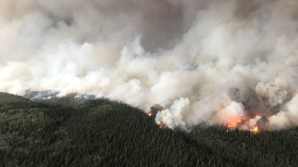 The South Stikine River fire burns in an Aug.6, 2018 handout photo provided by the BC Wildfire Service. The BC Wildfire Service says its priority is to protect homes and properties in a northwestern B.C. community already hammered by a wildfire. (THE CANADIAN PRESS/HO-BC Wildfire Service)