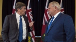 Ontario Premier Doug Ford and Toronto Mayor John Tory meet inside the Premier's office at Queen's Park in Toronto on Monday, July 9, 2018. A published report suggests the Ontario government is poised to reduce Toronto city council to just over half its current size. THE CANADIAN PRESS/Tijana Martin