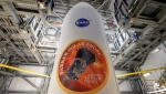 In this image provided by NASA, the United Launch Alliance Delta IV Heavy rocket payload fairing is seen with the NASA and Parker Solar Probe emblems, Wednesday, Aug. 8, 2018, at Launch Complex 37, Cape Canaveral Air Force Station, Florida. (Bill Ingalls/NASA via AP)