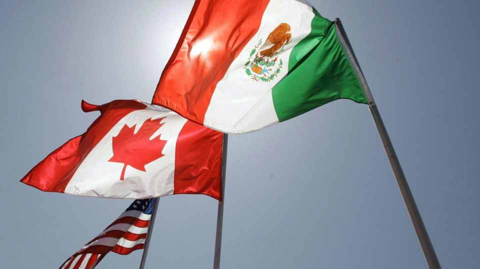 National flags of the United States, Canada, and Mexico fly in the breeze in New Orleans on April 21, 2008. THE CANADIAN PRESS/AP, Judi Bottoni