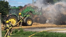 Fire crews battle hay bale fire