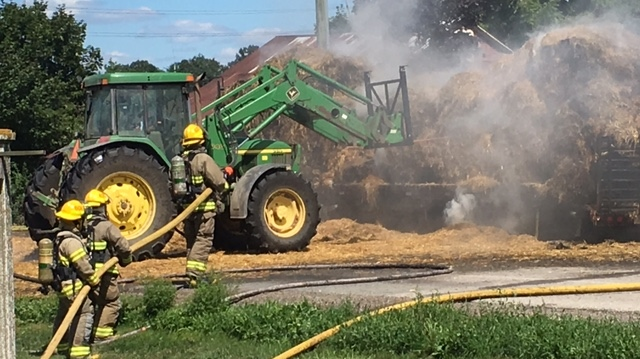 Crews are seen here battling a hay bale fire in West Montrose August 10, 2018.