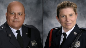 Fredericton police Const. Robb Costello, left, and Const. Sara Burns, right, have been identified as the two officers killed during a shooting in Fredericton, N.B. on Friday, Aug. 10, 2018. (Fredericton police/ Twitter)