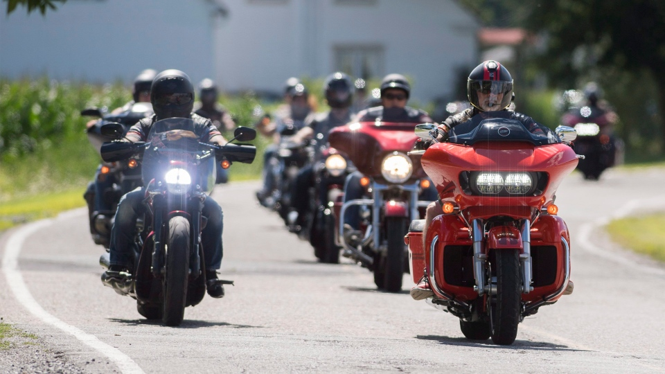 Members of the Hells Angels arrive for a national gathering in Saint-Charles-sur-Richelieu, Que., Friday, August 10, 2018. (Graham Hughes/ The Canadian Press)
