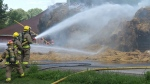 Fire crews battle massive hay fire