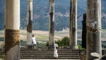 Tourists walk through the ruins of the ancient Roman site of Volubilis, near the town of Moulay Idriss Zerhounon in Morocco's north central Meknes region, on July 25, 2018. (Fadel Senna/ AFP)