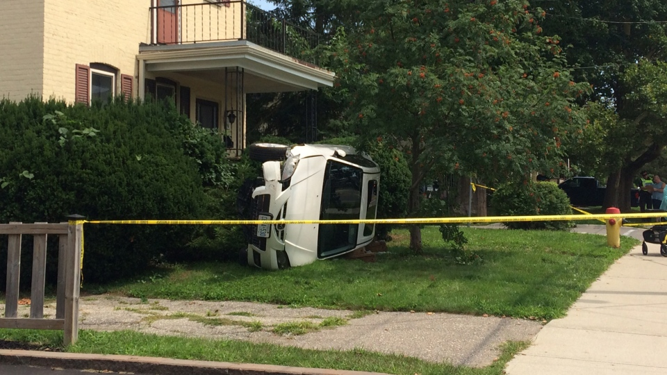 A vehicle attempting to avoid a collision ended up on its side on a front lawn, police say.