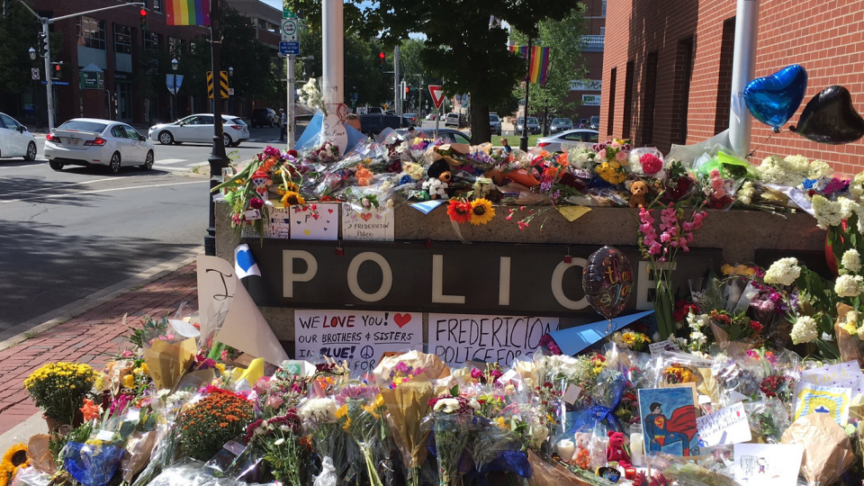 Many personal messages, including support from beyond the city, are being added to the growing memorial at the Fredericton police station.