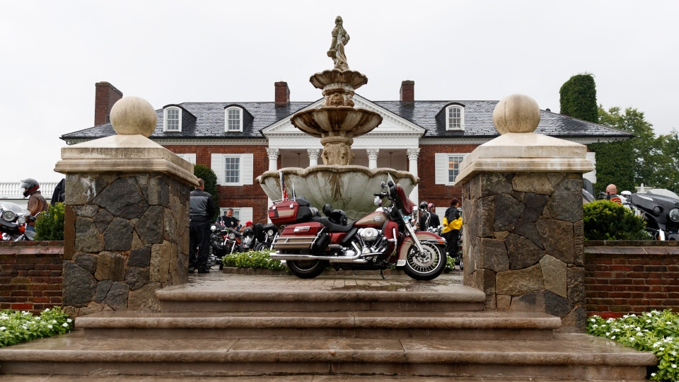 Motorcycles are parked in front of the clubhouse of the Trump National Golf Club in Bedminster, N.J., Saturday, Aug. 11, 2018, before President Donald Trump met with members of the Bikers for Trump group and supporters. (AP Photo/Carolyn Kaster)