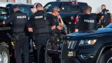 Police block a road in a Fredericton neighbourhood on Saturday, Aug. 11, 2018. THE CANADIAN PRESS/Andrew Vaughan